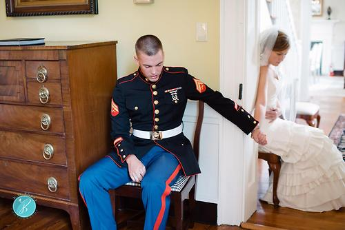 marine and bride praying before wedding